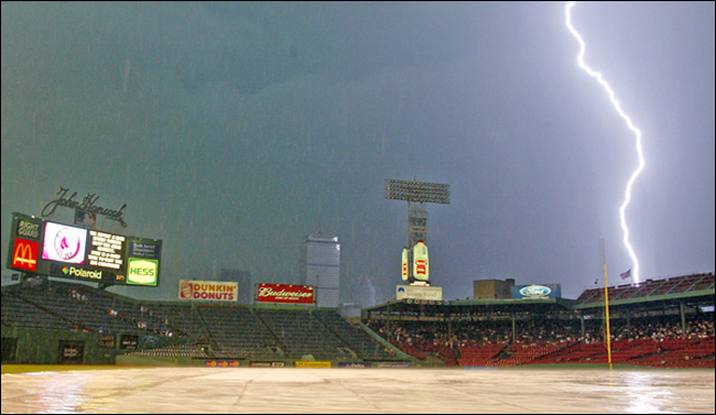 Lightning strikes near Fenway Park in Boston. Friday, Aug. 22, 2003. delaying the start of the Red Sox game with the Seattle Mariners. (AP Photo/Winslow Townson)